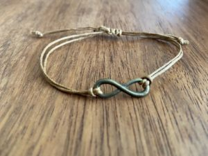 Brown rope bracelet with infinity charm